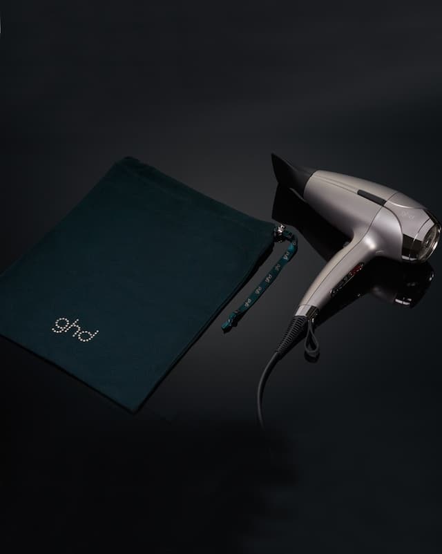 ghd helios in warm pewter with emerald dust bag